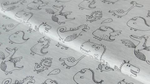 Hellgrau melierter Jersey: Cute Dragons - 150 cm kaufen im Makerist Materialshop