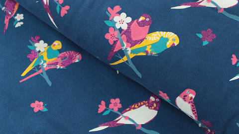 Dunkelblauer Baumwolljersey Sparkling Print: Papagei - 150 cm kaufen im Makerist Materialshop