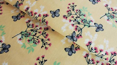 Hellgelber Jersey: Megan Blue Tricot Butterfly - 150 cm kaufen im Makerist Materialshop
