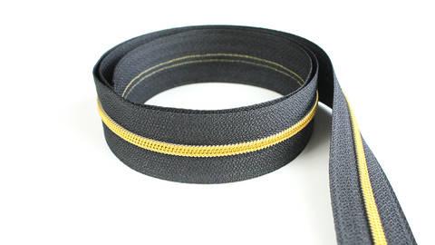 Endlosreißverschluss: gold-schwarz - 4 mm  kaufen im Makerist Materialshop