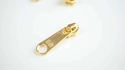 Reißverschluss-Schieber gold - 4 mm  kaufen im Makerist Materialshop