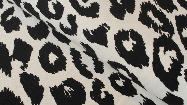 Sweatstoff ecru-schwarz: Leopardenmuster - 160 cm im Makerist Materialshop - Bild 1