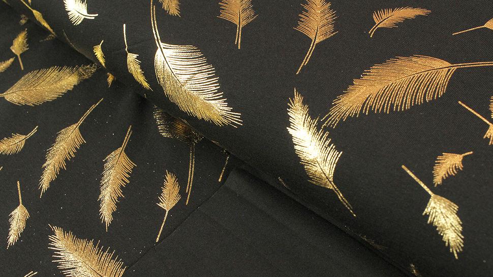 Baunwolljersey schwarz-gold: Metallic Federn - 150 cm 1 kaufen im Makerist Materialshop