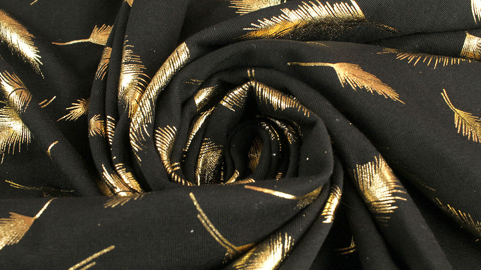 Baunwolljersey schwarz-gold: Metallic Federn - 150 cm 5 kaufen im Makerist Materialshop