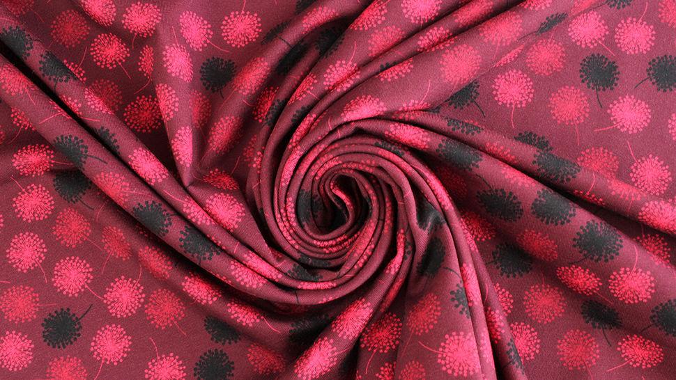 Baumwolljersey bordeaux: Avalana Pusteblumen - 162 cm kaufen im Makerist Materialshop