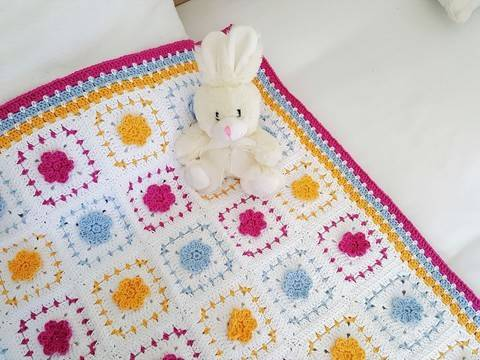 Download Crochet Blanket, Spring Flowers, Pattern No34, in both UK and US crochet terms immediately at Makerist