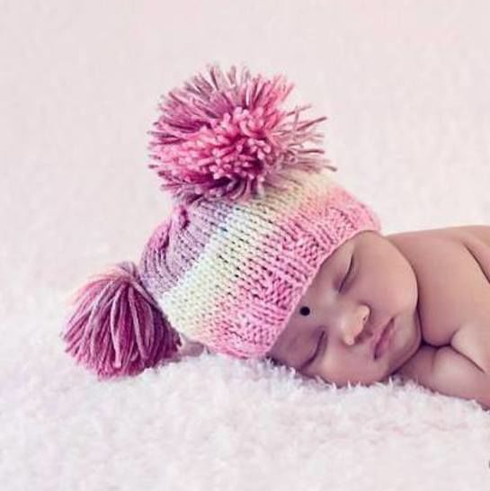 Download Easy Baby Tassel Beanie - Knitting Patterns immediately at Makerist