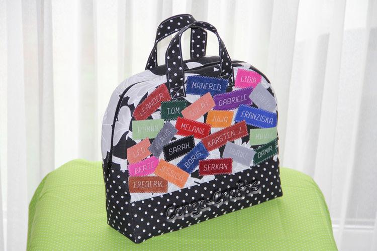 Makerist - Mini-Reisetasche mit Namen von Kollegen als Geldgeschenk - Nähprojekte - 1