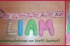 Makerist - Knisterbuchstaben aus Baumwolle und Bratschlauch für meinen Neffen (fast 1 Jahr) mit Befestigung für den Kinderwagen! - 1